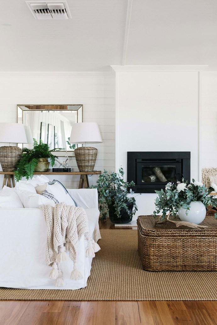 """Linen sofas set the scene in the all-white living room of the home. Rebecca sourced a number of cane pieces, including the coffee table in the living room, the base of the lamp in the sitting room and a large chest at the end of the bed in the master bedroom from [Flamingo Road Homewares](https://flamingordhomewares.com.au/ target=""""_blank"""" rel=""""nofollow"""")."""