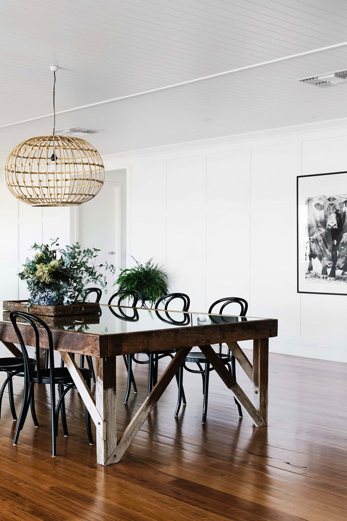 """A cane pendant light from [St Barts](https://st-barts.com.au/ target=""""_blank"""" rel=""""nofollow"""") hangs above a wool classing table, which was found in the shearing shed at the family's other property Evergreen, near Talwood."""