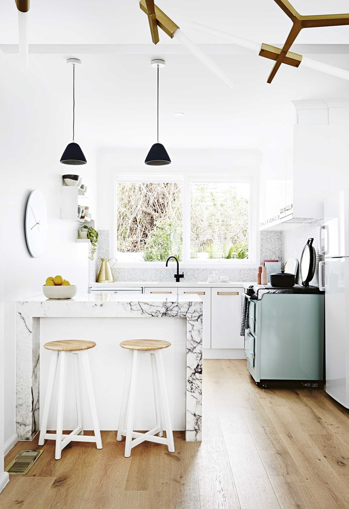 """The stunning marble [kitchen island](https://www.homestolove.com.au/kitchen-inspiration-13-of-the-best-island-benches-17943 target=""""_blank"""") is a striking visual feature in this space."""