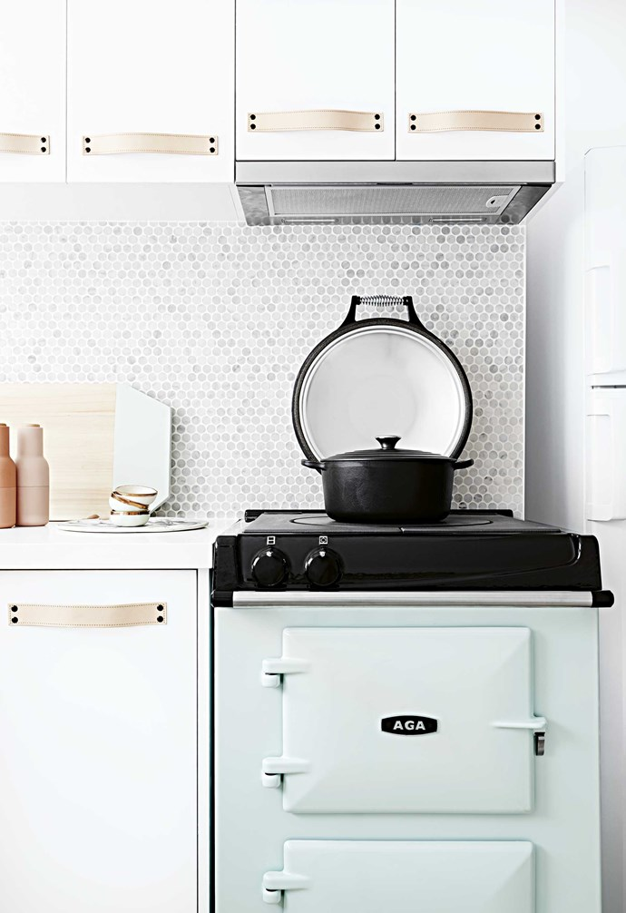 """The [colourful cooktop appliance](https://www.homestolove.com.au/colourful-kitchen-appliances-19988 target=""""_blank"""") adds warmth and a pop of playful personality to the kitchen."""