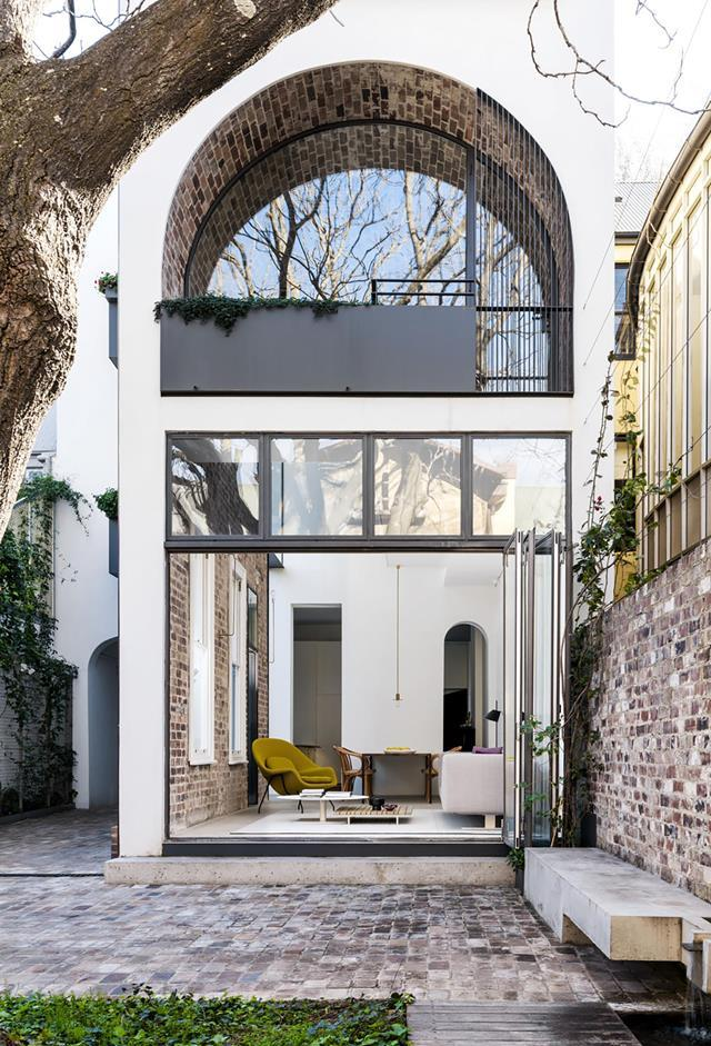 "Soaring ceilings and a brick barrel vault provide drama in this remodelled [1890s Sydney terrace](https://www.homestolove.com.au/remodelled-heritage-sydney-terrace-19592|target=""_blank"") house that was already a standout with its theatrical facade. Designed by Renato D'Ettorre Architects. *Photograph*: Justin Alexander. From *Belle* February/March 2019."