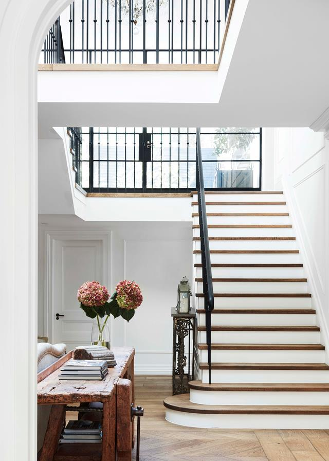"With its juxtaposition of modern and traditional – a flowing wrought-iron balustrade and classic wall panelling teamed with industrial steel-framed windows and skylight – [this entryway](https://www.homestolove.com.au/gothic-revival-home-19307|target=""_blank"") could belong in a Belle-Époque Parisian townhouse. Designed by Hancock Architects. *Photograph*: Prue Ruscoe 