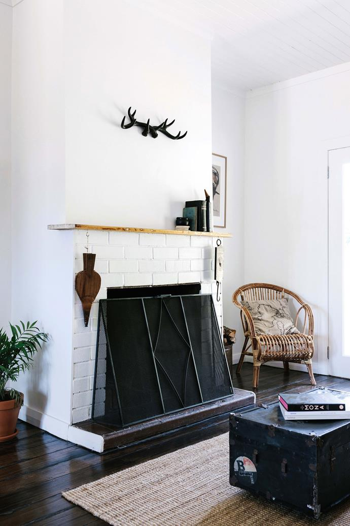 Josh used salvaged timber to make the mantelshelf in the living room.