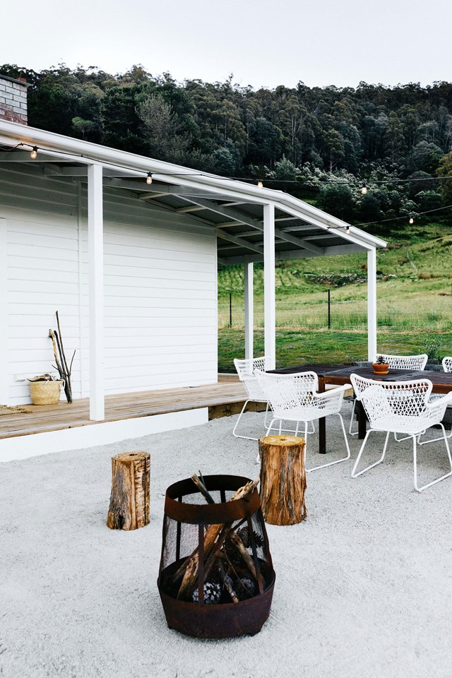 "At this renovated [farm cottage in Tasmania's Huon Valley](https://www.homestolove.com.au/farmhouse-restoration-tasmania-20104|target=""_blank""), this low-maintenance outdoor area, complete with a large table for entertaining and fire pit, allows the owners and their guests to soak up the surrounds. ""We sit there on the timber stools Josh made, just looking at the fire — it's like nature's TV,"" they say."