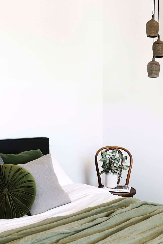 """The linen bed cover and cushions are from Launceston store The Vintage Rose, while the pendant lights are from [Ecoco](https://ecoco.com.au/collections/lighting
