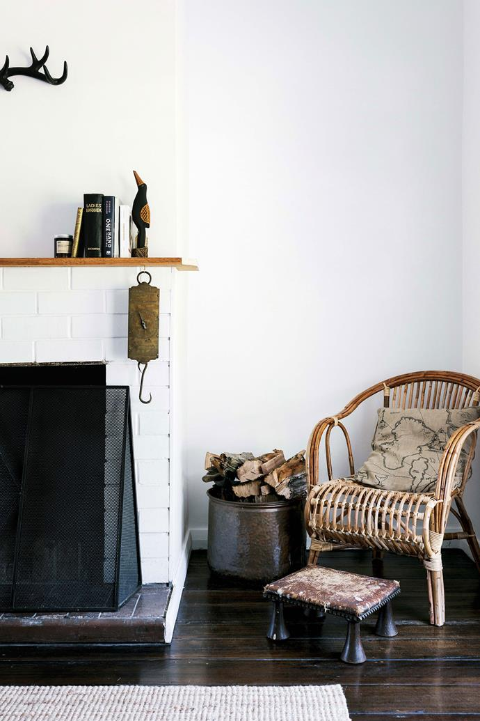 """The living area of the historic cottage was decorated to create a sense of place. The footstool was found in a farm shed and the cane chair is from [The Importer](https://www.theimporter.net.au/ target=""""_blank"""" rel=""""nofollow"""") in Kingston."""
