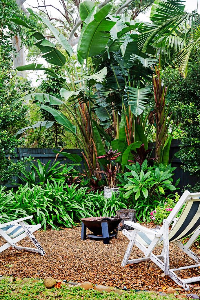 "A holiday inspired the design of this tropical, [Bali-style garden](https://www.homestolove.com.au/bali-style-garden-1877|target=""_blank"") in Sydney's Northern Beaches.The fire pit from Bunnings is a nice addition to the backyard, especially in winter. *Photograph*: James Henry"