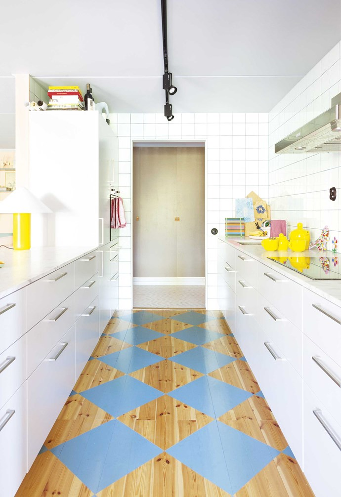 "**Bright idea** Take an old pine floor and create a new look with a tile-style pattern. ""It's a traditional Swedish way of painting wooden kitchen floors, which began when tiles were expensive,"" says Daniel."