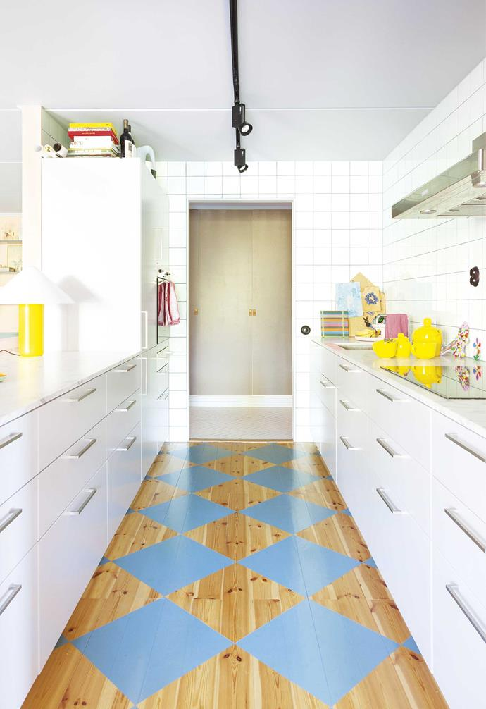 """**Bright idea** Take an old pine floor and create a new look with a tile-style pattern. """"It's a traditional Swedish way of painting wooden kitchen floors, which began when tiles were expensive,"""" says Daniel."""