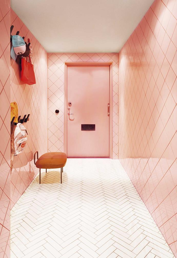 **Entrance hall** Daniel fully committed to tiles near the front door, laying pink ones diamond-style on the walls (outlined with terracotta-toned grouting) and white ones in a herringbone pattern on the floor. Plenty of hooks keep bags and hats off the