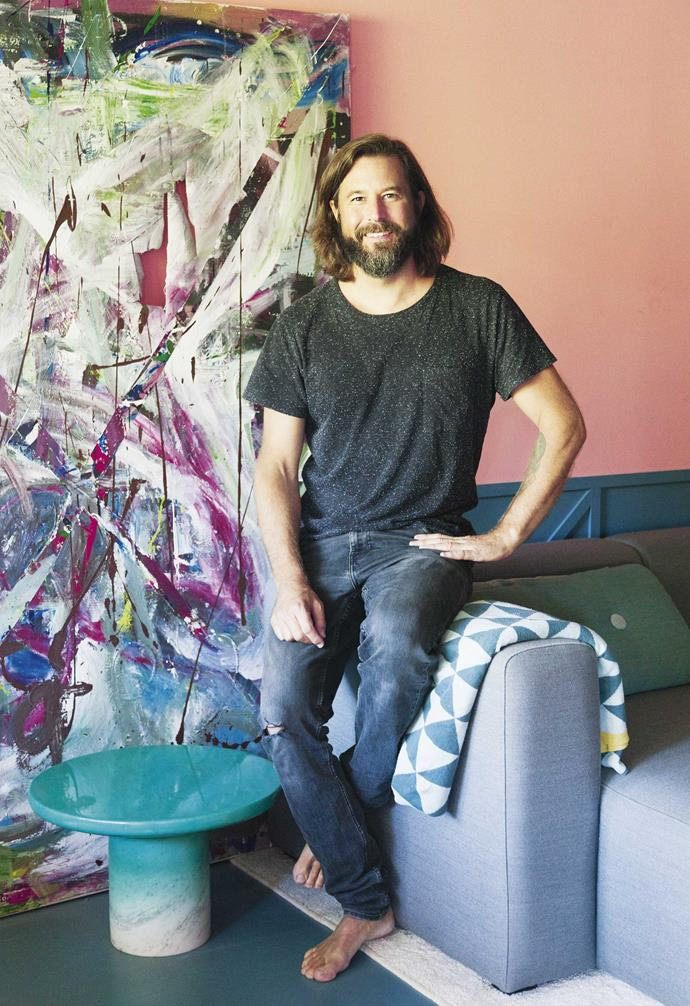 """**Living area**  Homeowner Daniel in front of his 35th birthday present. """"I had a big party and put up a canvas on the wall for people to paint — this is how it looked at 4am!"""" Hay 'mags' sofa, [Cult](https://cultdesign.com.au/ target=""""_blank"""" rel=""""nofollow""""). Painted-marble table, [Nick Ross](https://nckrss.com/ target=""""_blank"""" rel=""""nofollow""""). [Ferm Living](https://www.fermliving.com/ target=""""_blank"""" rel=""""nofollow"""") throw."""