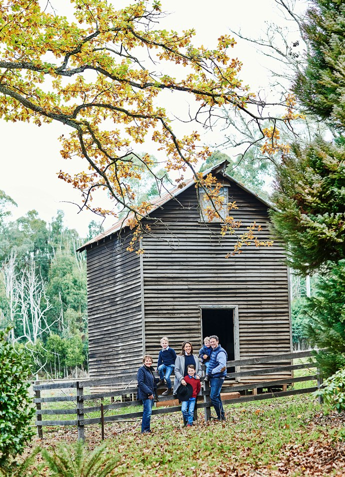 """The family, including Bridget's mother Maria, Tom, Bridget, Max, Angus and Anthony, outside an old barn at Tarnpirr.  Although they're not sure how the name came to be, Bridget thinks it is a reference to an Indigenous word for """"flowing water""""."""