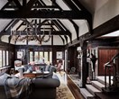 A Tudor style homestead with dark timber interiors