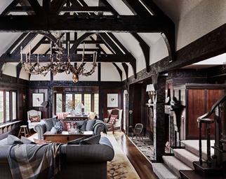 Lodge style living room with dark timber panelling and cathedral ceiling