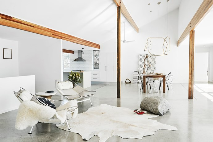 "The entranceway area consists of two Hans Wegner 'Flag Halyard' chairs, a cowhide rug and a granite boulder from a local quarry. ""I think it brings a gallery element to the space,"" Amanda says."