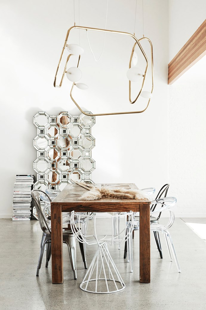"""I love this light from Amonson Lighting; it's like a line drawing dotted with sculptures,"" Amanda says. The dining chairs came from vintage stores, Gumtree and an art gallery she worked for prior to starting Oracle Fox."