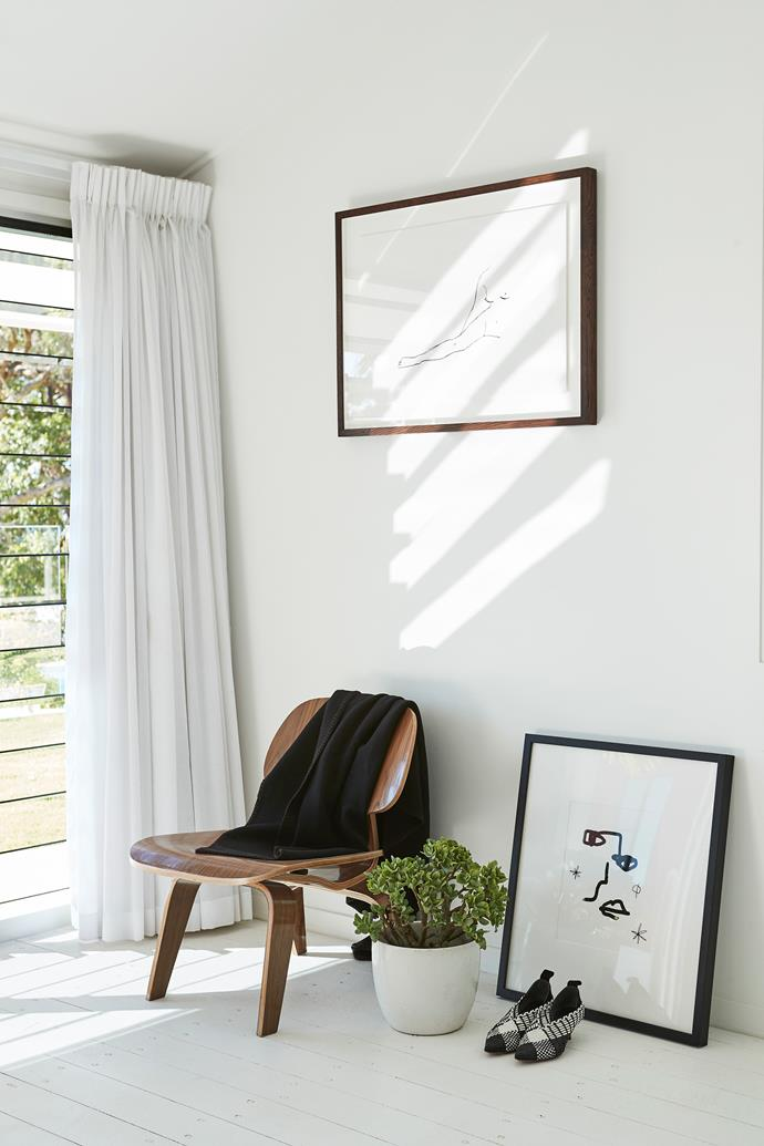 An Eames 'LCW' chair and Hermés throw create a cosy corner in the bedroom.