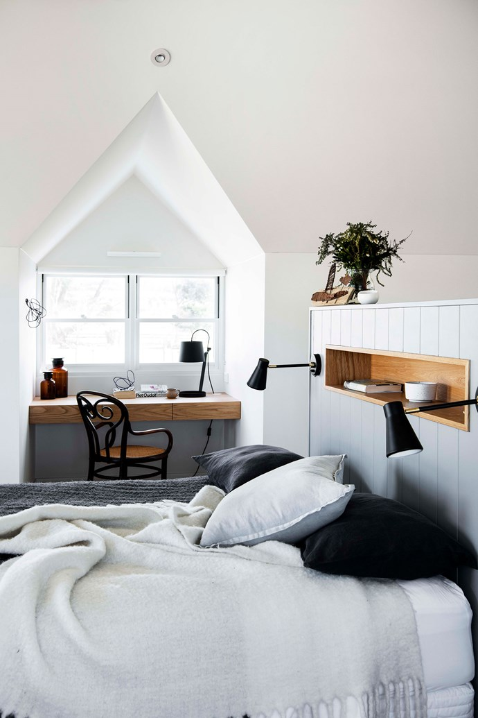 The couple's master bedroom is filled with natural light. By the window, they've created a desk nook including a café chair from Revival Antiques and 20th Century Design in Milton.