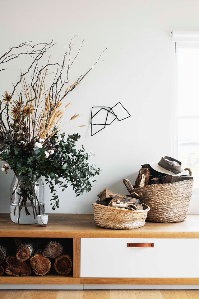 "A rustic arrangement of silvercoin gum, dried flowers and branches makes a sculptural statement in the living room of this charming [home in Milton, NSW](https://www.homestolove.com.au/sea-change-home-renovation-20164|target=""_blank"")."