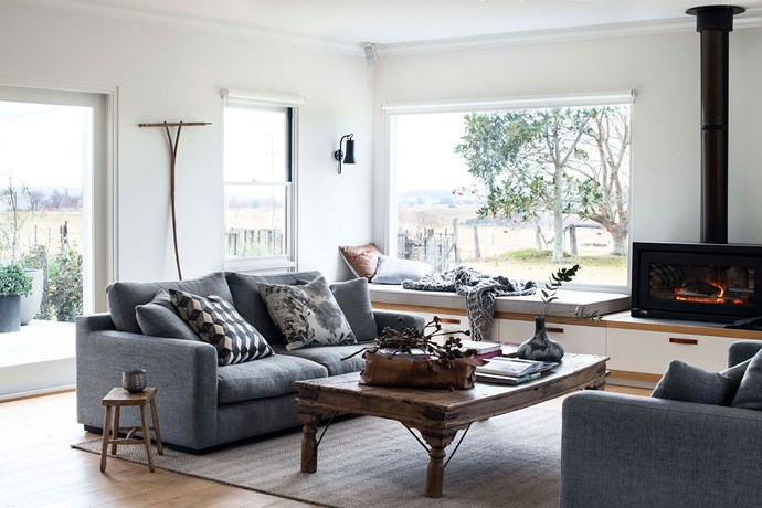"""Allan's favourite spot is this picture window complete with knitted throw from Spaces 2538 in Milton. A [Bonnie and Neil](https://www.bonnieandneil.com.au/ target=""""_blank"""" rel=""""nofollow"""") Flowering Gum cushion sits on one of the Boyd Blue sofas covered by Christina Prescott Design."""