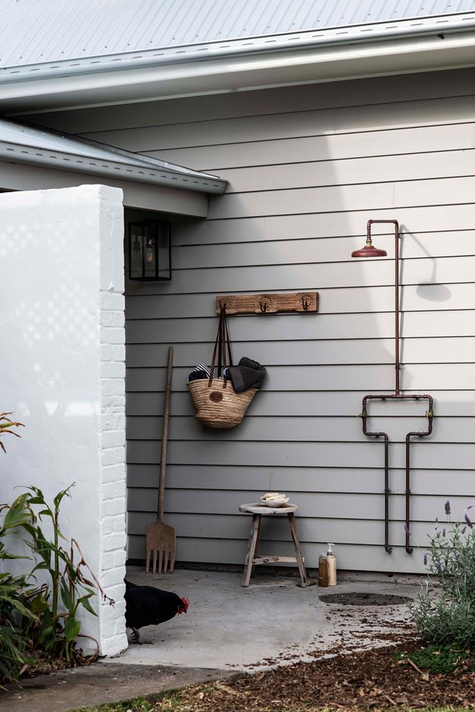 Some of Jenny's antique gardening tools alongside the outdoor shower.