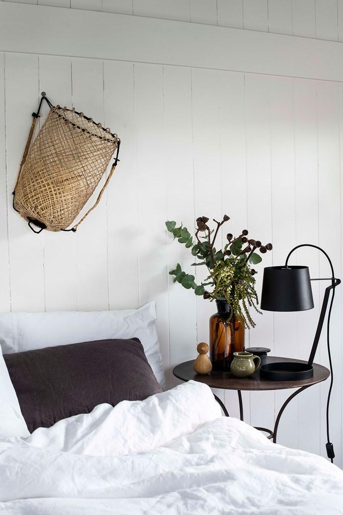 "A lamp from [Beacon Lighting](https://www.beaconlighting.com.au/ target=""_blank"" rel=""nofollow"") illuminates the bedroom."