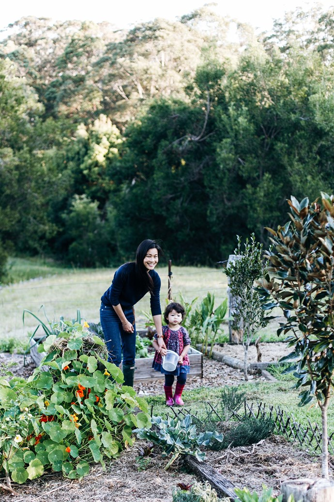 Del with her daughter Ellie walking through the farm's vegie patch.