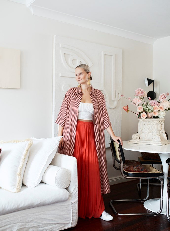 Phoebe is as chic as her living space. She bought the dining chairs at an auction house.
