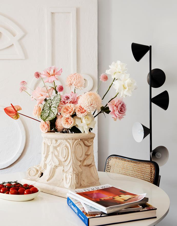 An ornate vase from The Vault Sydney makes for an eye-catching statement in the dining area.
