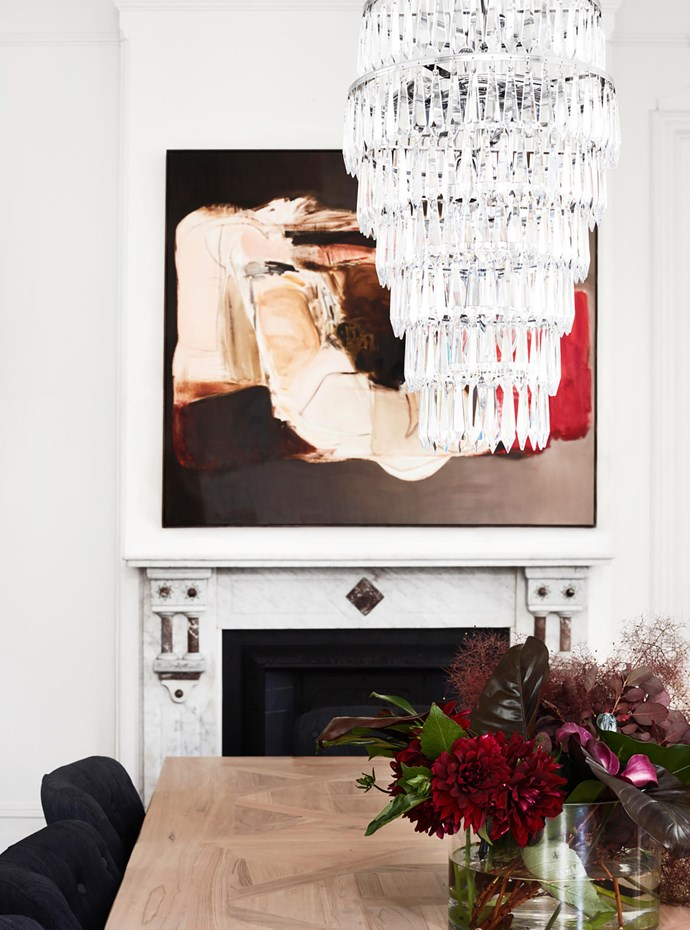Waterford Crystal 'Etoile' chandelier from Cult hangs above the MCM House table. Chairs from Coco Republic. Artwork by Lisa Lacroix from Otomys.