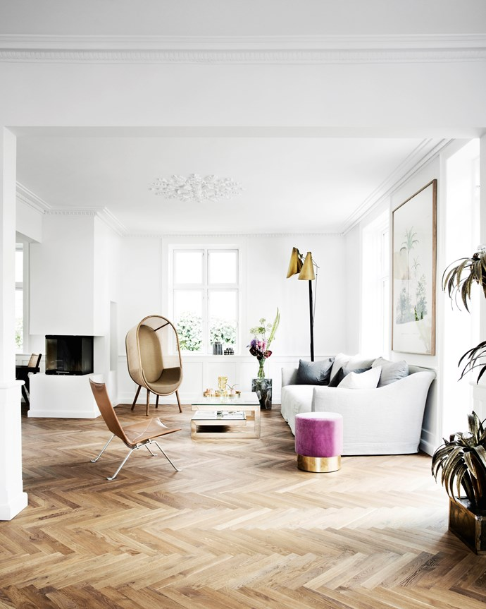 Pernille's love of Scandi brands is evident throughout her home. Also in the living area are a leather chair by Poul Kjærholm (a family heirloom) and Cocoon chair by Danish duo Kevin Hviid and Martin Kechayas. A FOS floor lamp stands in one corner while a sleek fireplace connects the living and dining areas.