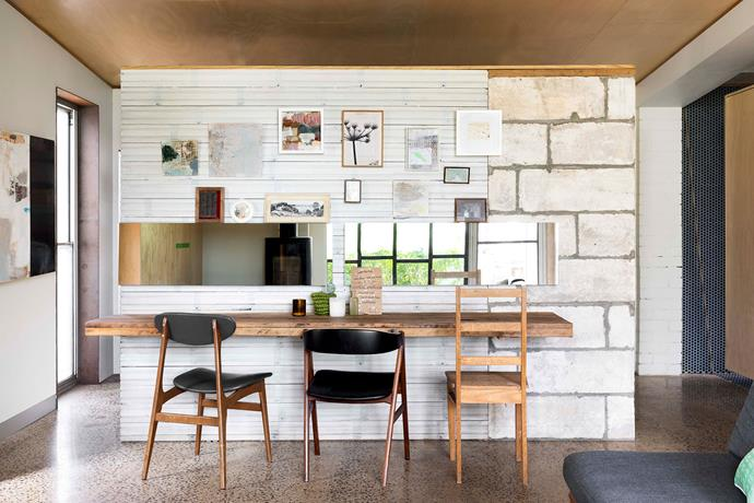 Upcycled floorboards and limestone form the dividing wall. The chairs were found on eBay and at Chapel Street Bazaar.