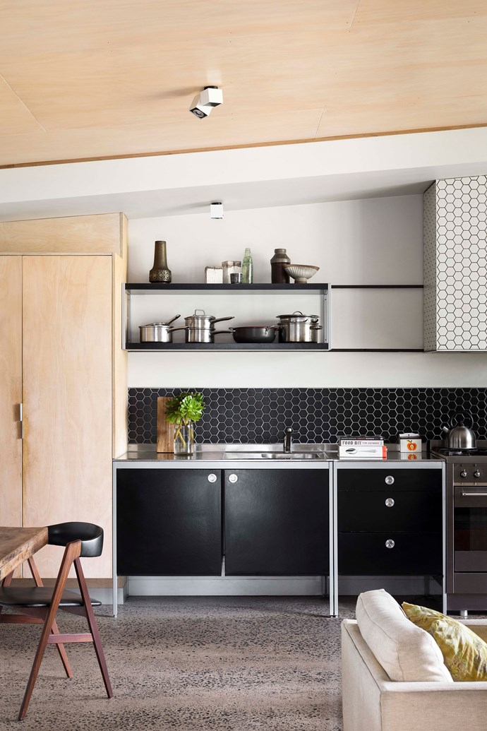 """Hexagonal tiles from Academy Tiles give the family's kitchen artistic flair. The black Udon kitchen cabinets were sourced from [IKEA](https://fave.co/2P0kuI9