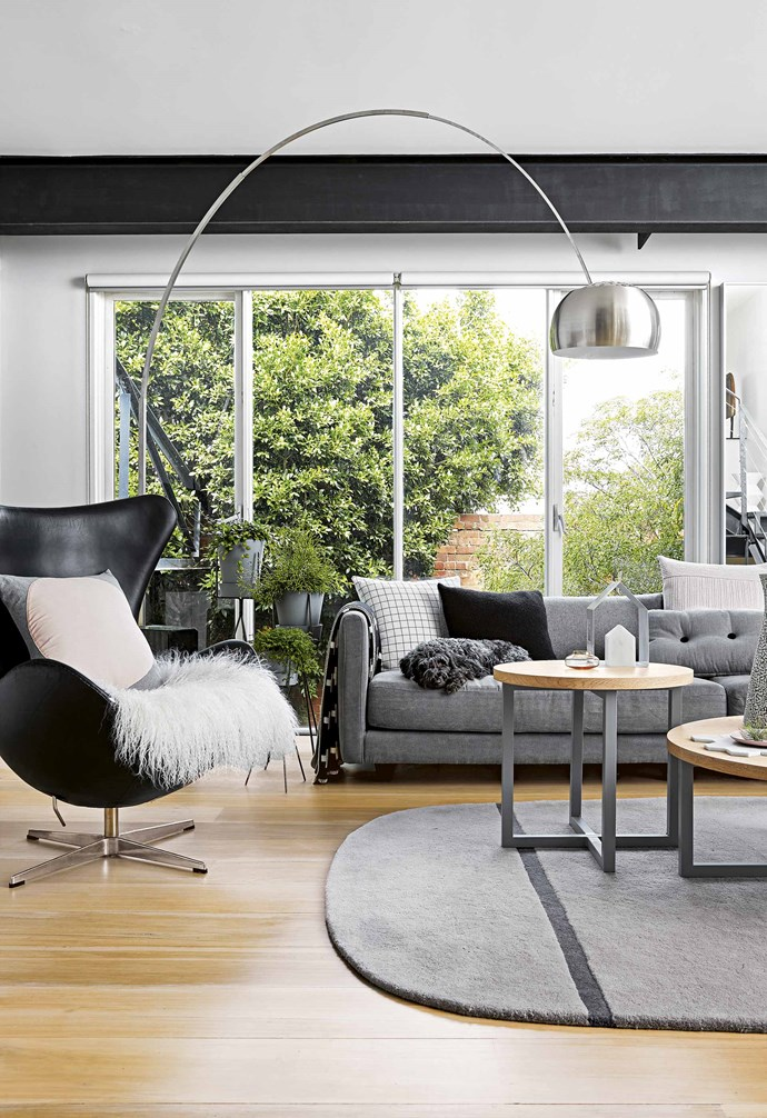 "First though, he had to go to China on a buying trip, and while there – as had become his habit - casually started flicking through a real estate website back home. Five minutes later, a [converted Richmond warehouse](https://www.homestolove.com.au/home-conversion-ideas-19765|target=""_blank"") – designed by architect Michael Jan, who Craig had long respected for his affinity with industrial-style properties – had captured his heart.<br><br>**Living area** ""Being able to look through glass walls into different areas of the home while relaxing on the sofa gives me room to breathe after a long day at work,"" says owner Craig of this first-floor living zone. Pieces from [MRD Home](https://mrdhome.com.au/