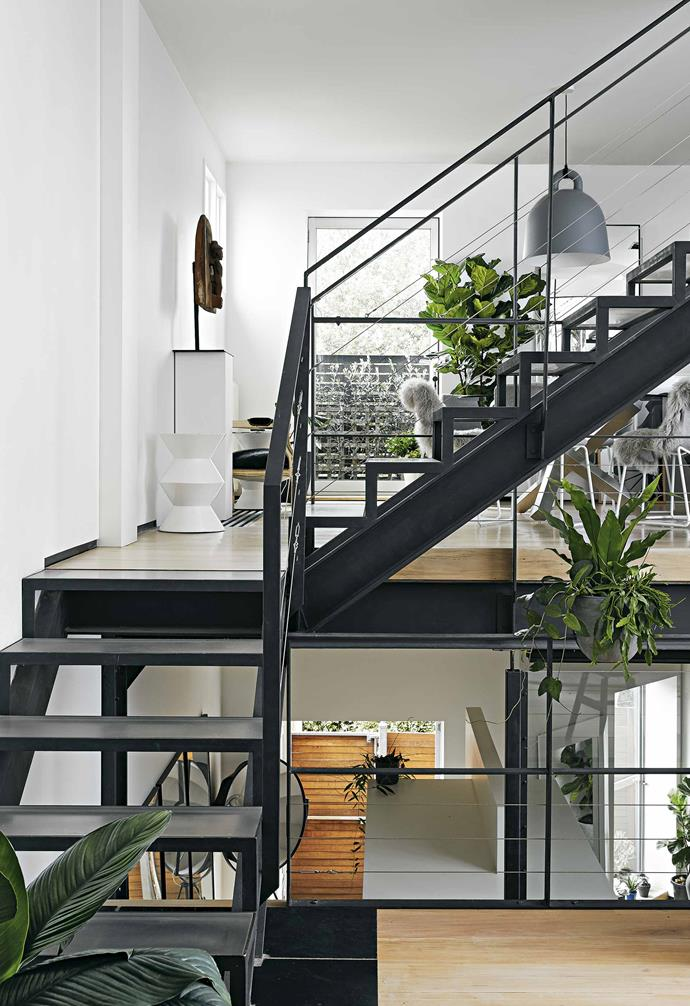 """""""I'd been to dinner at Michael's place in the city - he was one of the first people to live in an entire floor of a warehouse – and I really loved his aesthetic,"""" explains Craig. """"So I saw this place and just went 'Wow'.""""<br><br>**Staircase** During the renovation process Craig replaced the original stair treds in the home."""