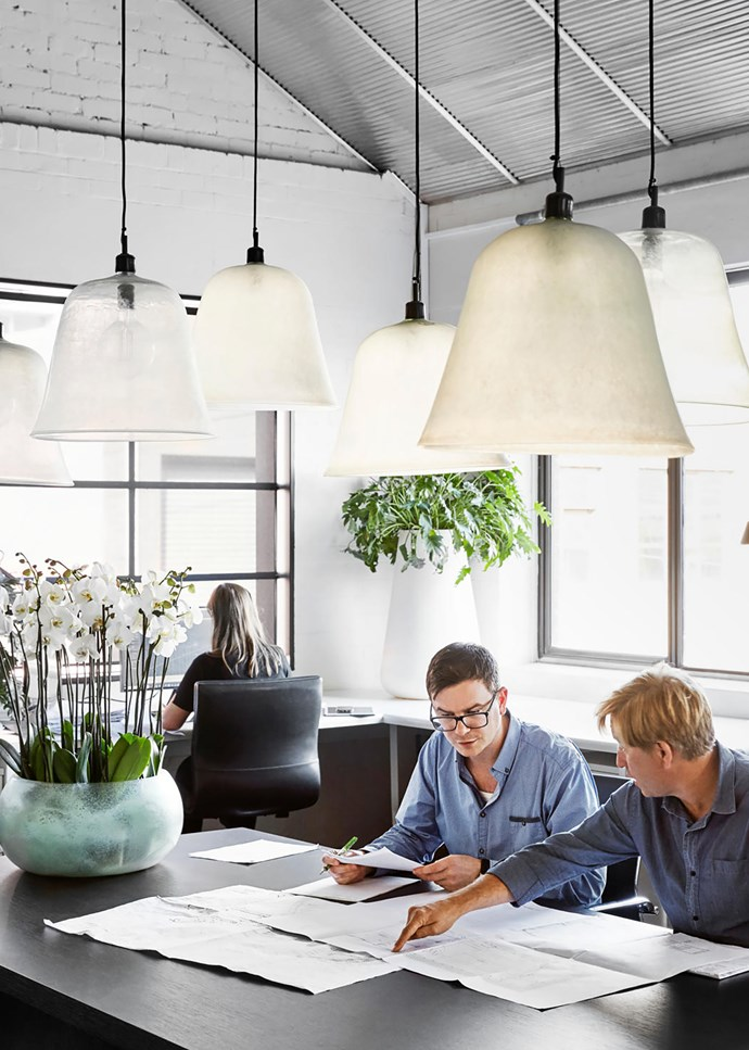 A collection of cloches converted into lights by Paul Bangay Design.