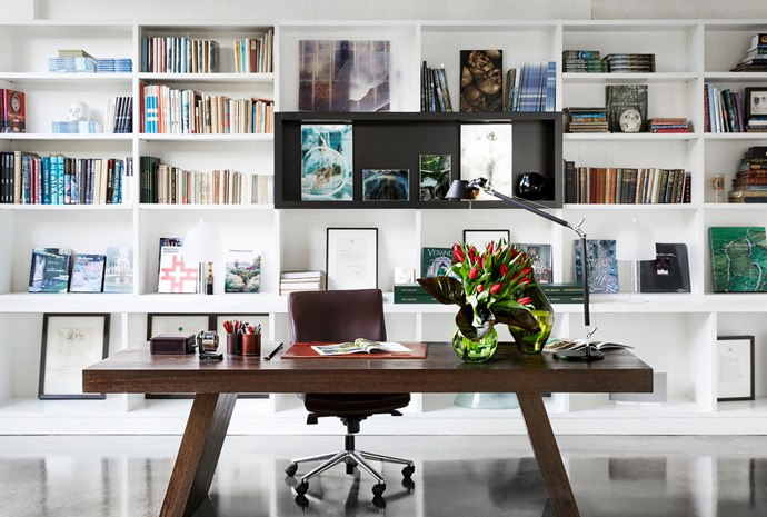 Ample shelving accommodates antique books and objects.