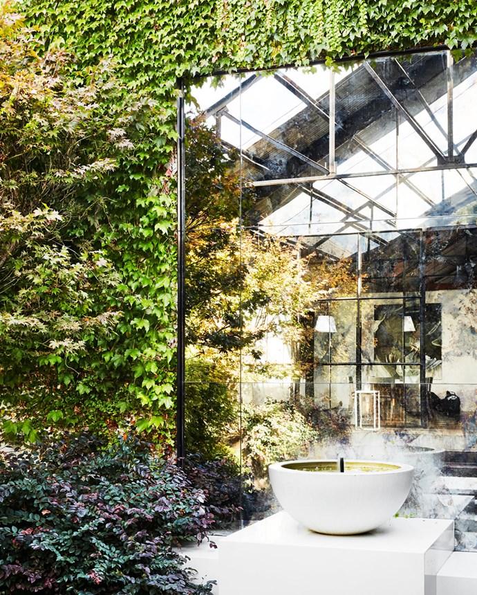 Antique mirrors create the illusion of depth. Parterre fountain.