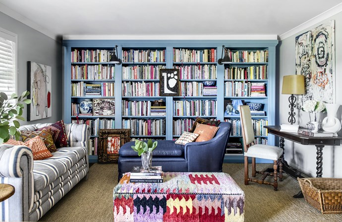 With a custom shade on the bookshelves, vintage carpet and kilim cushions from New York, this room showcases the family's love of books and travel. The sofa was made to order in A Rum Fellow 'Ipala Stripe' fabric in Ocean, and the antique chaise reupholstered by CW Howell in Melbourne. Sisal rug, Portobello Home. Artworks (from left) by Lola Santiago, John Taylor (also on floor and far right) and Sue Carroll, with a vintage find. Smart move: Ottoman custom-made using a Loom Rugs design that was previously in the hallway.