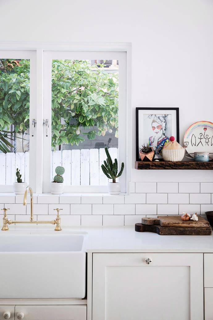 Consider replacing your kitchen splash back. There are a number of affordable products on the market which can make a dated space feel brand new. *Photo: Chris Warnes / bauersyndication.com.au*