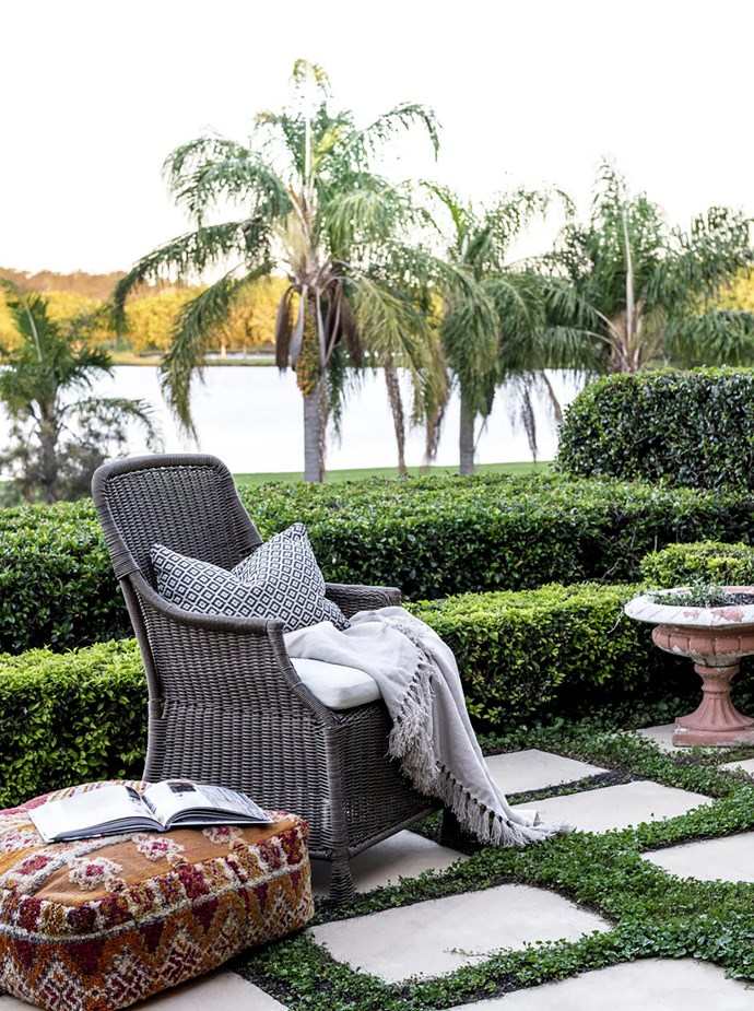 Views of the local golf course contribute to the lush outlook from the kitchen. Chair, Pottery Barn. Design classic: Moroccan floor cushion/ottoman.