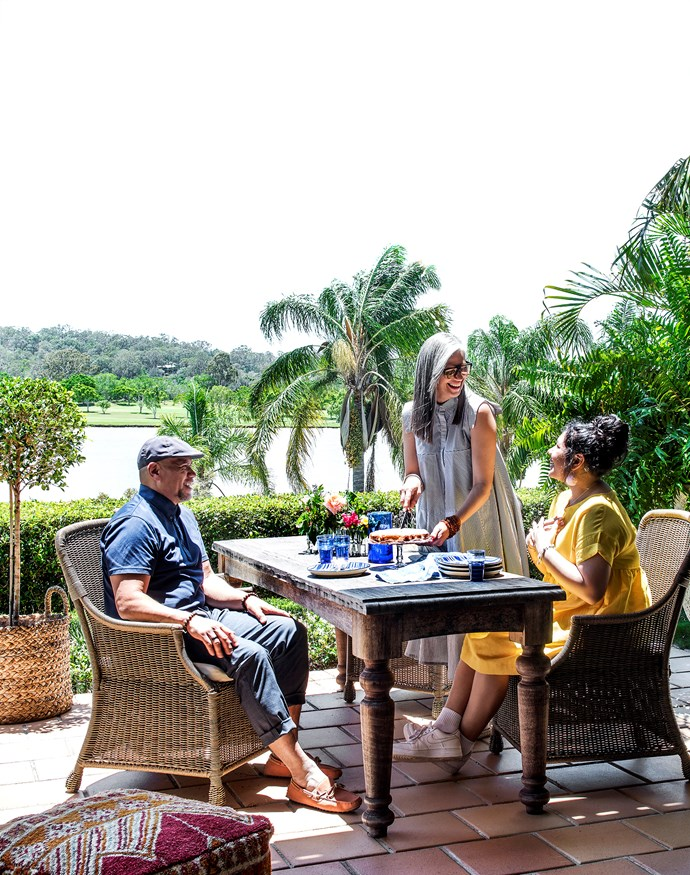 AJ, Bronnie and Kayziah in a much loved – and used – area of the home. AJ and Bronnie handpicked the recycled planks of timber for their custom-made table.