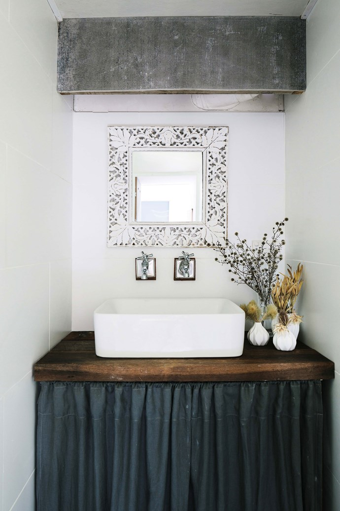 """A plank of reclaimed timber forms a bathroom vanity. Lisa says shopping for building materials and furniture on [Gumtree](https://www.homestolove.com.au/how-to-buy-and-sell-on-gumtree-3533