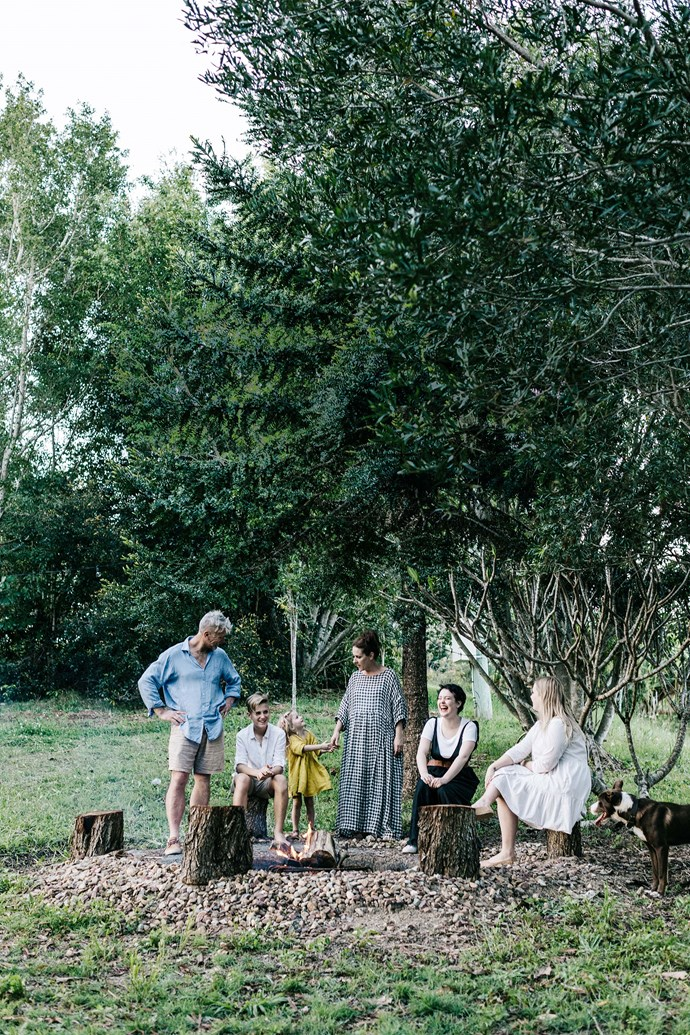 Bruce and Lisa Williment with their children Sebastien, Anais, Paris and matisse, plus Koa the border collie cross kelpie, around the fire pit.
