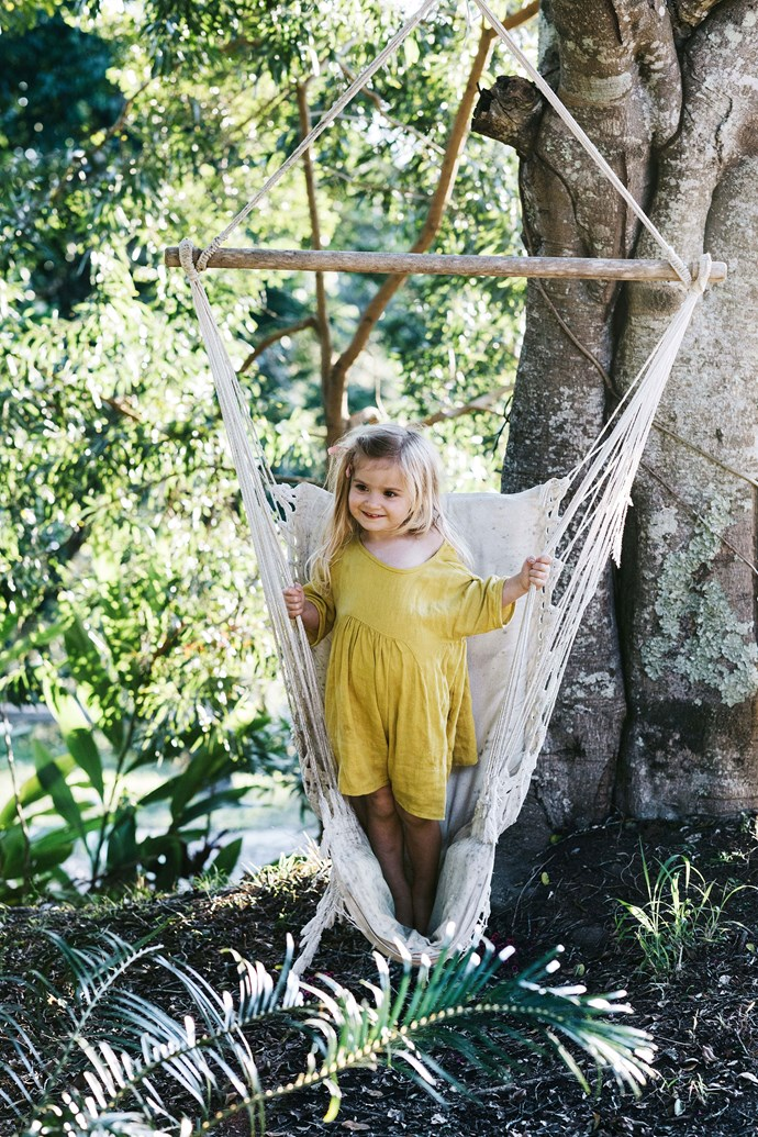 """A hammock swing in the garden is one of Anais' favourite spots to play. During their time in the shed house, which they have dubbed the """"shouse"""", the family have added herbs, and vegetables to the garden along with other citrus fruit trees."""