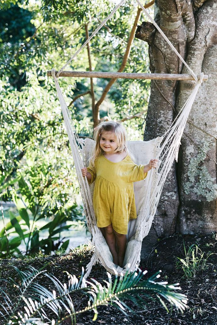 "A hammock swing in the garden is one of Anais' favourite spots to play. During their time in the shed house, which they have dubbed the ""shouse"", the family have added herbs, and vegetables to the garden along with other citrus fruit trees."