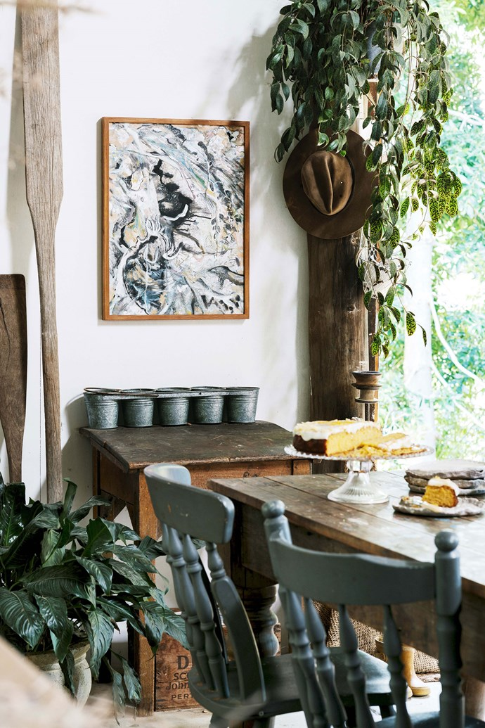 In the dining area, a painting titled Petrified Forest by Rosie Lloyd-Giblett provides a stunning focal point.