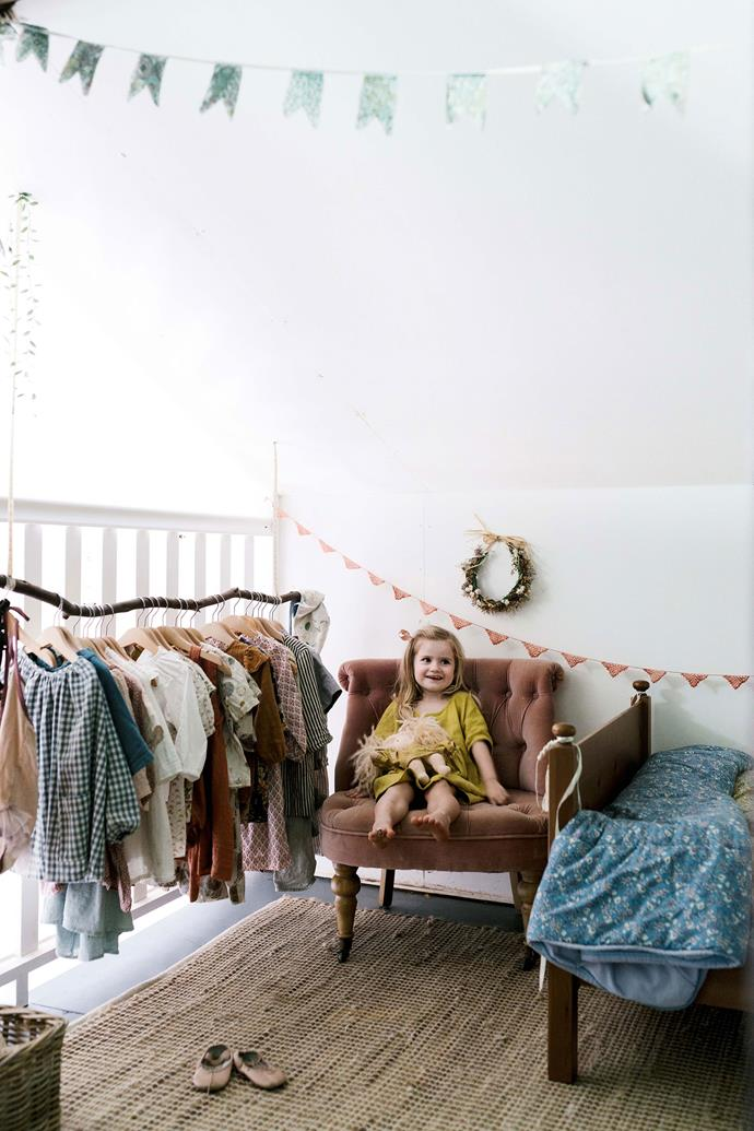 "Three-year-old Anais in her bedroom. An old tree branch has been suspended from the ceiling to provide hanging space for her clothing. The chair is from [Early Settler](https://www.earlysettler.com.au/|target=""_blank""