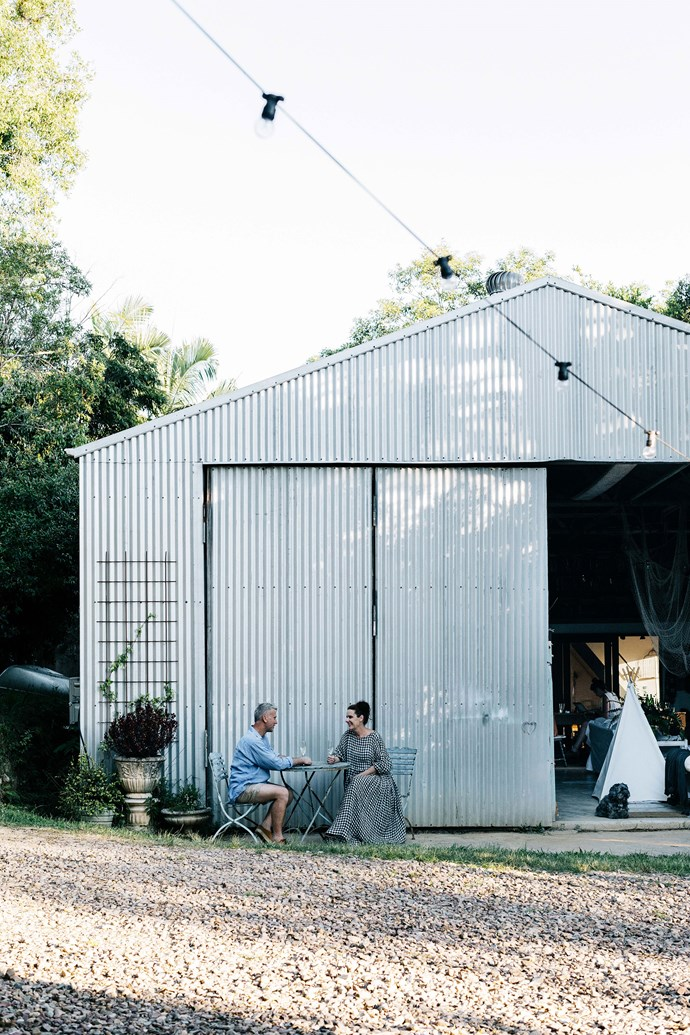 The exterior of the shed has remained largely untouched. After purchasing a property on the Sunshine Coast in 2016, Lisa and Bruce set about converting the corrugated iron shed into a temporary family home. Now, years later, the shed is a comfortable and unique home that the entire family loves.