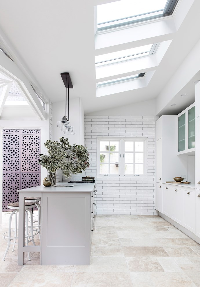 Large tiles in hues that capture the colours of the earth are a stunning feature, both indoors and out. Thanks to its textural beauty, this style lends itself well to an otherwise minimalistic decorating scheme. *Photo:* Maree Homer / *bauersyndication.com.au*